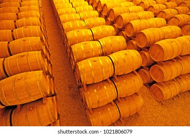 Pile of whisky barrels in storage room