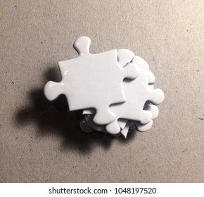 Pile of white puzzle / close up of puzzle pieces