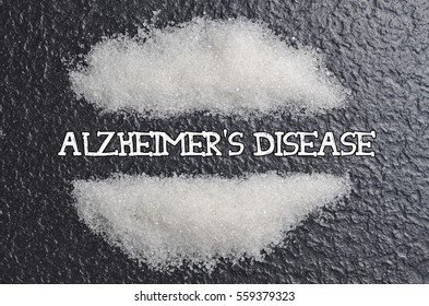 """A pile of white sugar with copyspace written with """"Alzheimer's disease"""""""