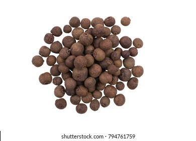 A pile of whole allspice, jamaica peppe isolated on white background