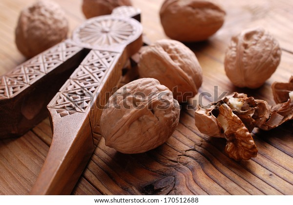 pile of whole walnuts on wooden table