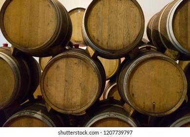 pile of Wine barrels in wine-vaults storage