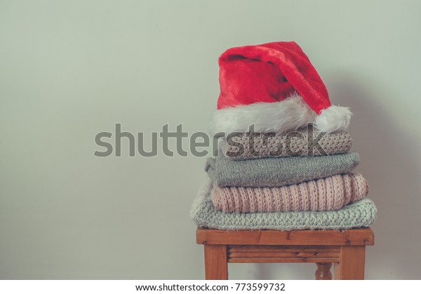 pile of winter clothes and Santa hat
