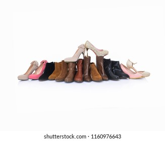 Pile of Women's shoes on white background