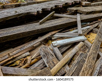 Pile of wood not use ,old wooden heap from old house for scrap.