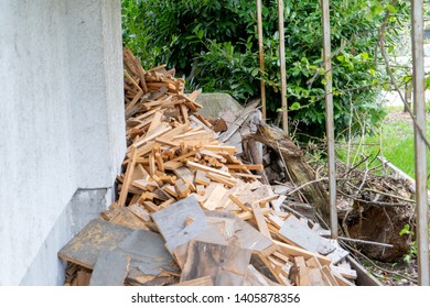 Pile of wood scraps cut up, or ready to be re-used and recycled, or otherwise considered junk rubbish. Wood from fence boards, or old furniture and lumber.