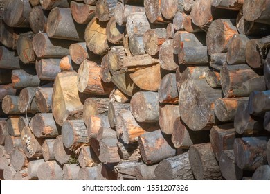 Pile of Wood, Stack of Firewood Close Up, Background - Shutterstock ID 1551207326