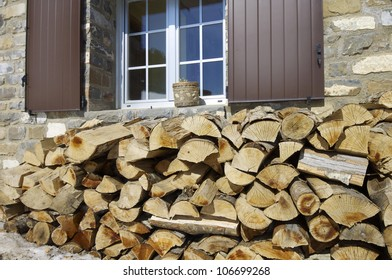 pile of wood under the window,Pyrenees, Spain