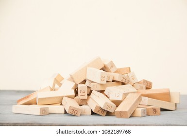 The pile wooden block on wooden table