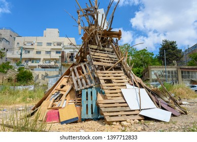 Pile of wooden board ready on festive Lag Baomer bonfires in a orthodox suburb of Jerusalem Israel.