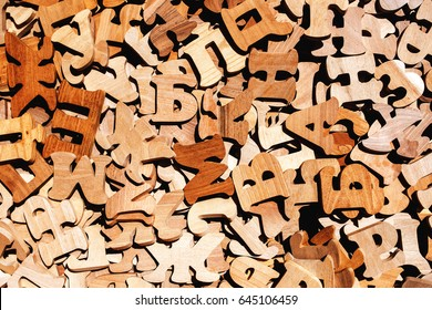 Pile of wooden letters as literacy and education background