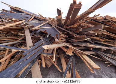 Pile of wooden planks at demolition site ready for hauling away for the recycling.