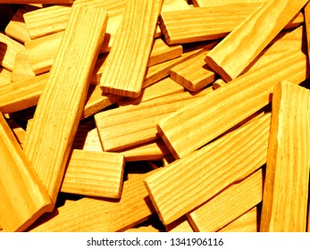 A pile of wooden sticks that a re used as a tow to build buildings and other constructions.