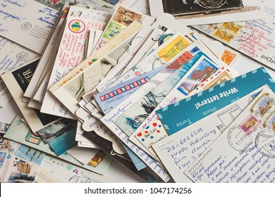 Pile of written postcards in disorder. Postcrossing footage. Postal mail. 2018.