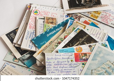 Pile of written postcards in disorder. Postcrossing footage. Postal mail. 2018