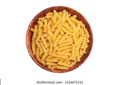 Pile of yellow pasta in wooden bowl isolated on white. Raw food dinner ingredient in round kitchen container background.