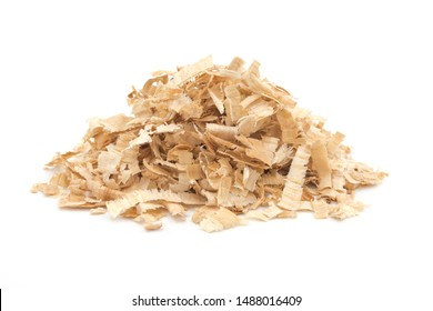 A pile of yellow sawdust wood pieces on a white background