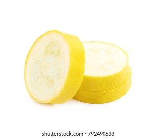 Pile of yellow zucchini slices isolated over the white background