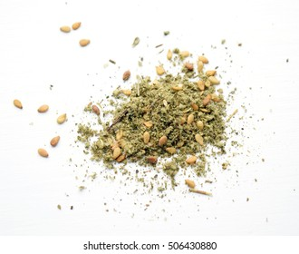 Pile of zaatar (za'atar), a middle eastern spice mix with sesame seeds, salt, oregano, thyme, and marjoram - isolated
