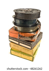Piled 16 mm / 30 meters (100 ft) motion picture film reels and boxes, isolated over white background