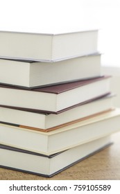 Piled up books on desk
