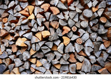 piled dry chopped firewood logs