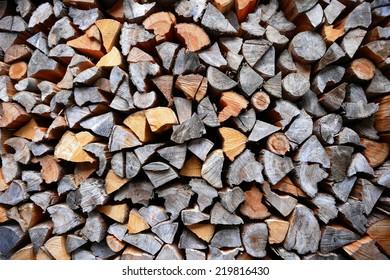 piled dry chopped firewood logs