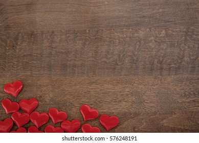 piled hearts on a wooden background flat lay