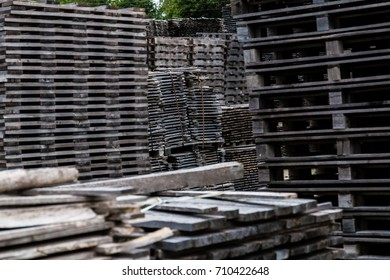 Piled of old and gray timber planks
