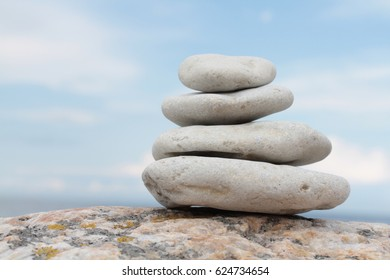 piled on top of each other the stones background sky