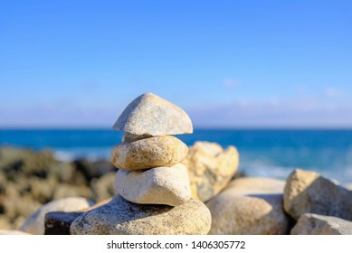 Piled Rocks and Beautiful Ocean Background