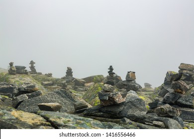 Piled stones are houses for Norwegian fairytale trolls. Troll house made from stones. Tourists are building troll houses out of stones, according to legend, trolls are hiding in these houses.
