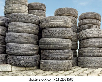 Piled used and worn car tires