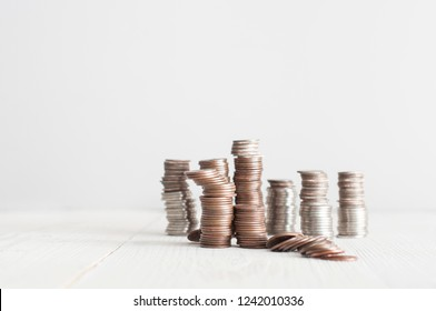 piles of american cents on white background