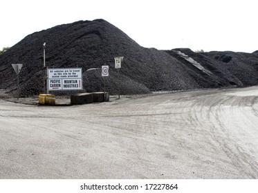 piles of black coal in a coal mine stockton- australia