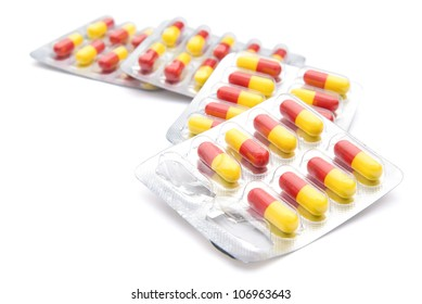 piles of capsules with clipping path