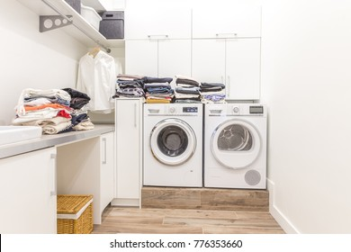 Piles of clean clothes in laundry room