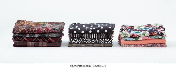 Piles of clothers on white background