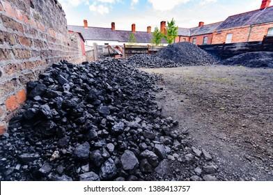 Piles of coal at a coal yard