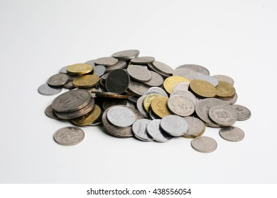 Piles of coins on isolated white background
