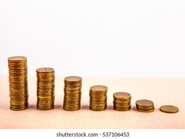 Piles of the Coins on the Table