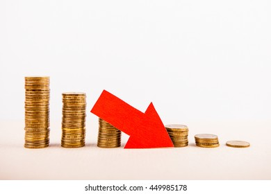 Piles of the Coins with Red Arrow Down
