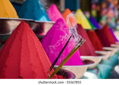 Piles of colored powders in an Indian market - holi colors.