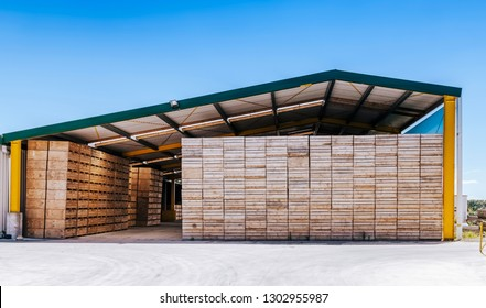Piles of crates in agricultural building in Te Puke, New Zealand.