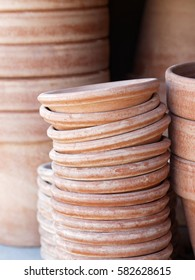 Piles of crocks made of terracotta used by the gardener