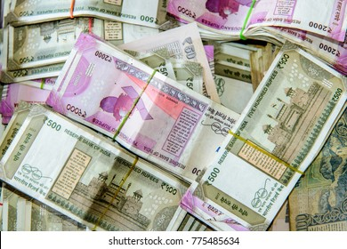 Piles of currency Indian Rupees in notes of 2000s and 500s