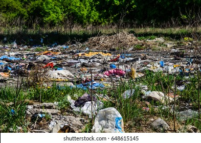 Piles of the different garbage on a ground