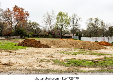 Piles of dirt hauled into vacant residential lot in early spring to prepared for construction