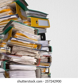 piles of file binder with documents on white paper background