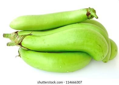 piles of fresh green eggplants